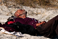 Homeless Man Sunning on Neptune Beach_CDS1949